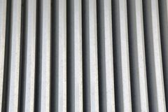 Line of steel. Metal grating formed by parallel lines Royalty Free Stock Photos