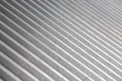 Line of steel. Metal grating formed by parallel lines Stock Photo