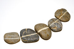 Line on stones. Five stones with continuous white line stock photography