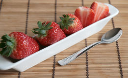 Line of strawberries in a white porcelain pot Royalty Free Stock Image