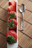 Line of strawberries in a white porcelain pot Royalty Free Stock Photography