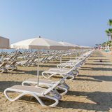 Line of sun beds and Umbrellas on a Larnaca beach Royalty Free Stock Image