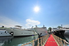 Line of super luxury yachts at the Singapore Yacht Show 2013 Stock Image