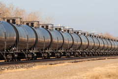 Line of Tank Cars Into Distance. Railway Tank Cars in a Line Stock Image
