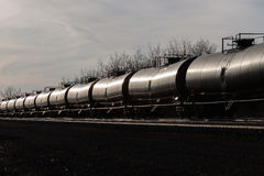 Line of Tank Cars Glinting in Sun Stock Images