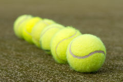 Line of tennis balls Royalty Free Stock Image