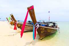 Line of Thai boats along a beach. Anchored boats on the beach of Chicken Island, in the gulf of Krabi Royalty Free Stock Images
