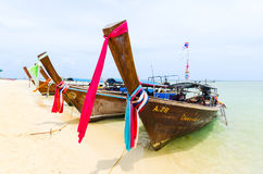 Line of Thai boats along a beach Royalty Free Stock Photo