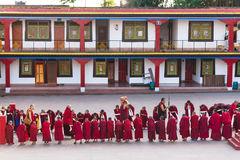 Line of Tibetan monks in front of Rumtek Monastery for welcoming high level monk near Gangtok. Sikkim, India. Royalty Free Stock Images