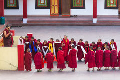 Line of Tibetan monks in front of Rumtek Monastery for welcoming high level monk near Gangtok. Sikkim, India. Royalty Free Stock Photo
