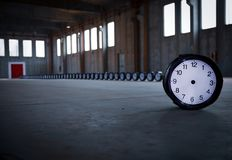 Line of Timepieces inside a warehouse stock image