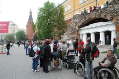 Line to the Eternal flame in which there were disabled people in carriages Royalty Free Stock Images