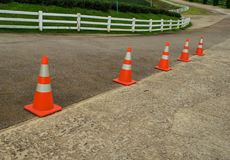 Line of traffic cone on concrete road. Line of traffic cone on concrete road in countryside Royalty Free Stock Photo
