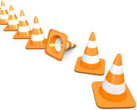 Line of traffic cones with one fallen cone. Diagonal line of traffic cones with one fallen cone, on white background Stock Image