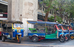 Line of tuktuks on Bangkok street Royalty Free Stock Photos