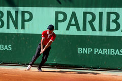 Line umpire at Roland Garros 2011. A line umpire in Roland Garros 2011 (game between Tomas Berdych and Stephane Robert). The ball was safe Stock Images