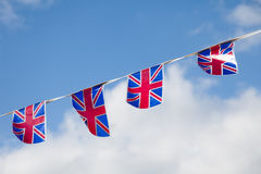 Line of Union Jack Bunting. A line of four union jack flag bunting against a blue sky.  Taken at the Diamond Jubillee celebrations Stock Images