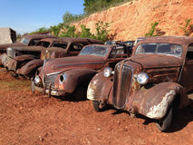 Line Up of Antique Automobiles. A lineup of classic American automobiles including a 1936 Chevrolet, 1940 Ford convertible and a 1938 Dodge Royalty Free Stock Photography