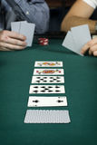 Line up of cards on poker table Royalty Free Stock Image