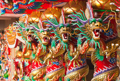 Line up golden dragons. In chinese temple Royalty Free Stock Photography
