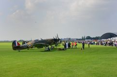 Line up of historic World War 2 spitfires with crowd Stock Images