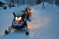 Line up of snowmobiles Royalty Free Stock Photography