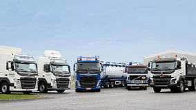 Line up of Volvo Trucks. LIETO, FINLAND - NOVEMBER 14, 2015: Volvo Trucks for different transport needs were presented at the Volvo Truck Center Turku Demo Drive royalty free stock images