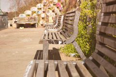 Line of urban benches sprayed with graffiti Stock Photos