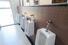 The line of urinall in the men`s toilet.  royalty free stock image
