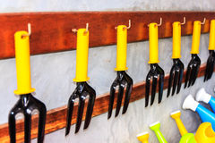 Line of used garden tool. Against the wall Stock Photos