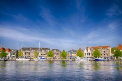 Line of Various Yachts and Travel Boats On One of Harlem City Channels in The Netherlands. Royalty Free Stock Photo