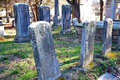 Aging headstones. A line of very old headstones show the wear of over a hundred years since they were made royalty free stock photography