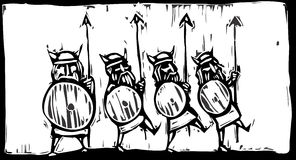 Line of Vikings. Woodcut image of a line of Vikings with spears and shields Royalty Free Stock Images