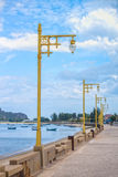 Line of vintage streetlights at seaside Royalty Free Stock Images