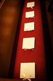 Line of wedding programs on a church pew. An image of a line of wedding programs on a church pew Stock Images
