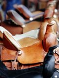 Line of Western Saddles. A Line of new Western Saddles for sale (shallow focus stock photo