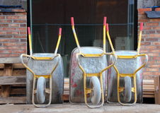 Line of Wheelbarrows at Construction Site Closeup Royalty Free Stock Image