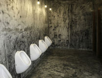 Line of white porcelain urinals Royalty Free Stock Photo