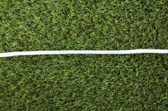 Line of white rope on grass Stock Images