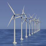 Line of wind generators at sea Royalty Free Stock Photos