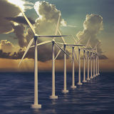 Line of wind generators at sea Royalty Free Stock Photography