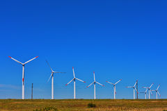 Line of windmills on the field Stock Photos