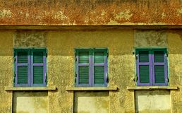 Line of windows. The colorful facade of an old house stock photography