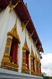 A line of windows  Ancient Golden carving wooden door of Thailand Royalty Free Stock Image
