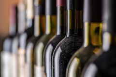Line of wine bottles. Close-up. stock photos