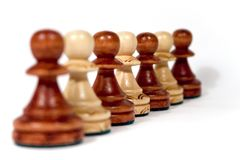 Line of wooden pawns Royalty Free Stock Image
