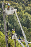 Line workers clean up damage in Vermont Stock Images