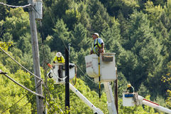 Line workers clean up damage in Vermont Royalty Free Stock Photography