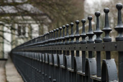 Line of wrought-iron fence spikes Stock Images