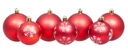 Line of xmas red balls isolated on white Stock Images
